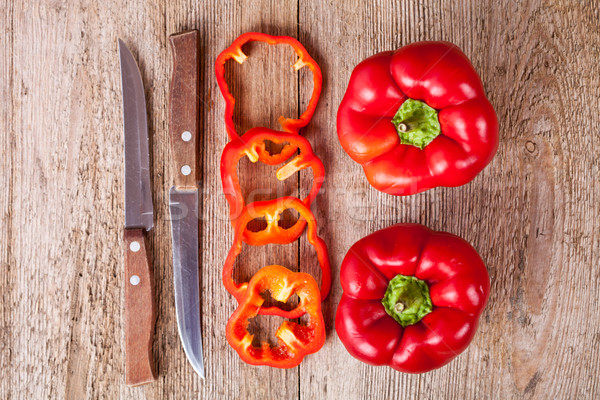 red bell peppers and old knifes  Stock photo © marylooo