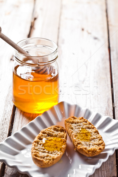 crackers in plate and honey  Stock photo © marylooo