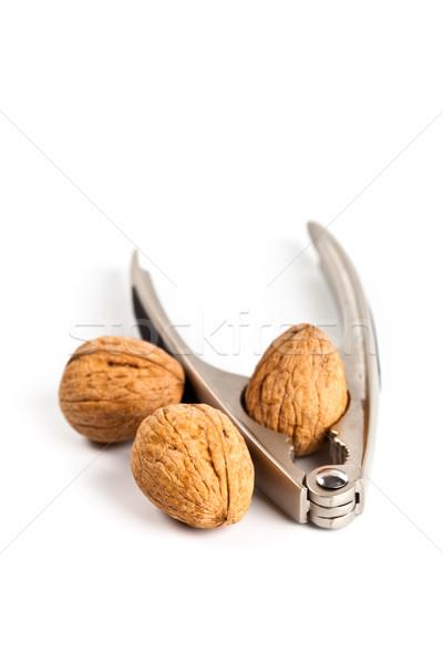 three walnuts and nutcracker  Stock photo © marylooo