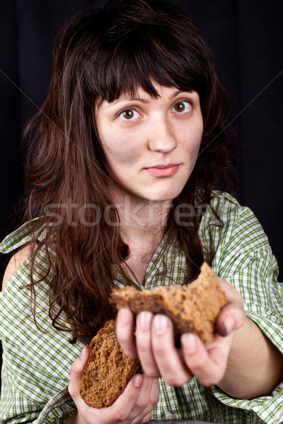 beggar woman with a piece of bread in her hands Stock photo © marylooo