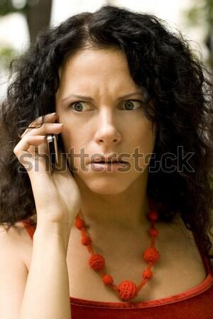 Jolie femme téléphone portable extérieur portrait femme sourire Photo stock © marylooo