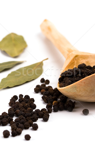black pepper on wooden spoon and bay leaves Stock photo © marylooo