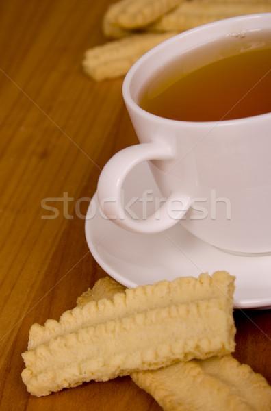 Fincan çay kurabiye ahşap masa ahşap içmek Stok fotoğraf © marylooo
