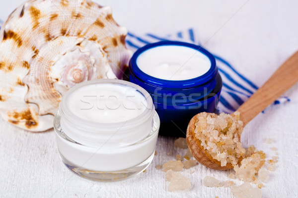 face cream in jars with sea salt and shell  Stock photo © marylooo