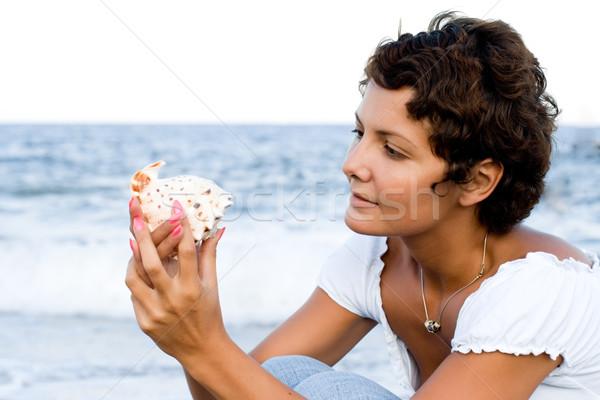 woman on seacoast with a cockleshell Stock photo © marylooo