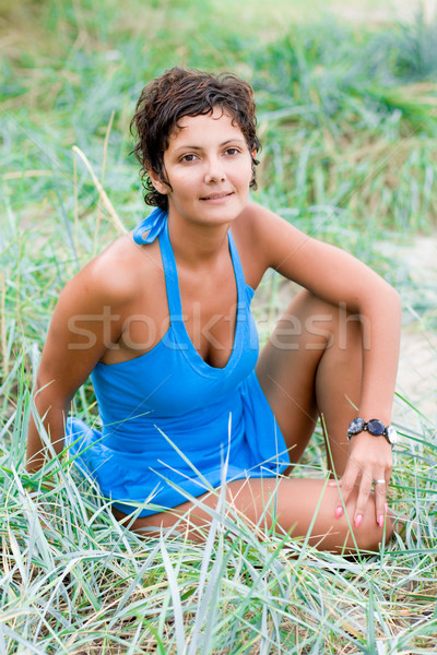 brunet woman sitting in a grass Stock photo © marylooo