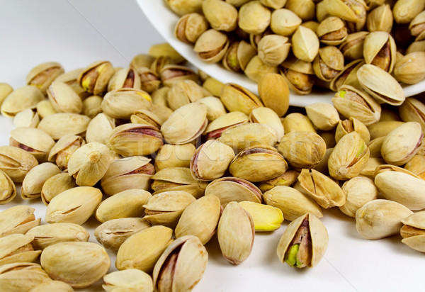 pistachios from bowl Stock photo © marylooo