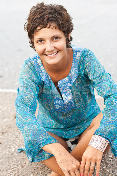brunet woman in blue dress on the beach Stock photo © marylooo