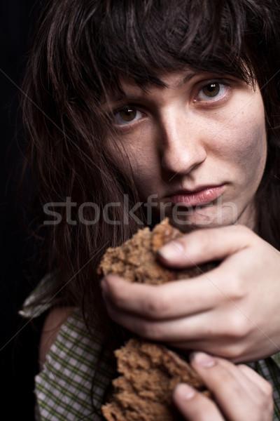 Koldus nő darab kenyér portré szegény Stock fotó © marylooo