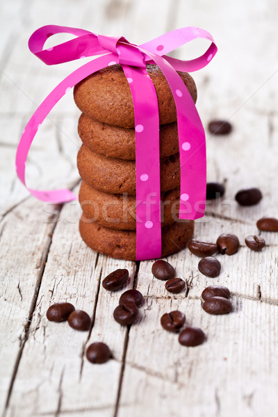 stack of chocolate cookies tied with pink ribbon and coffee bean Stock photo © marylooo