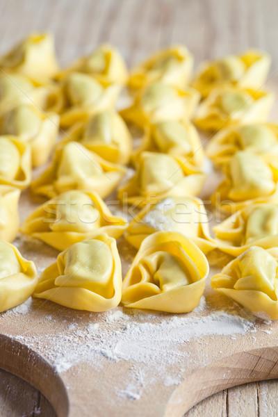 Tortellini közelkép fa deszka fa konyha sajt Stock fotó © marylooo