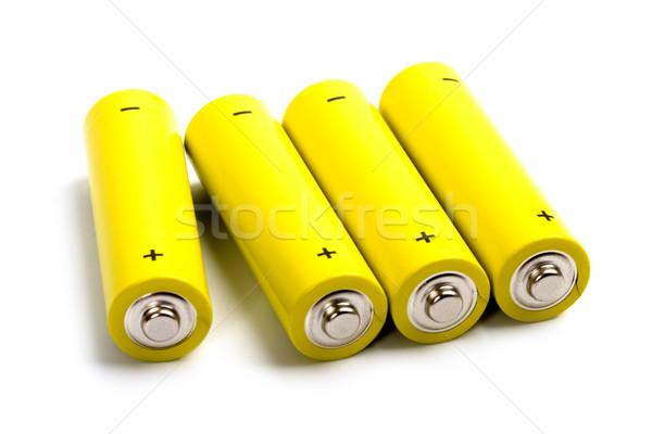 Stock photo: four yellow alkaline batteries