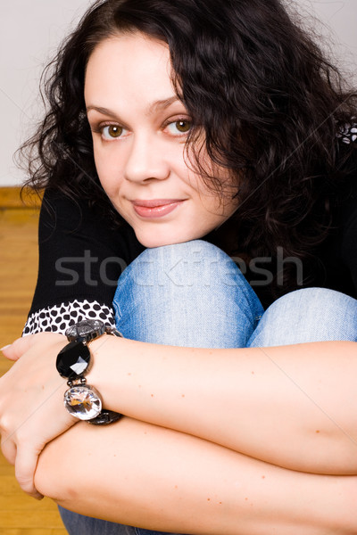 brunet woman sitting on a wooden floor Stock photo © marylooo