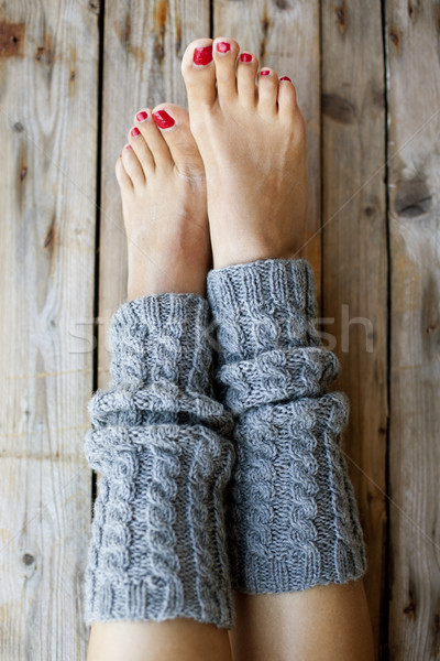 Woman's legs in knitted legwarmers. Stock photo © marylooo