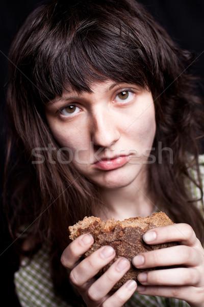 Koldus darab kenyér portré szegény nő Stock fotó © marylooo