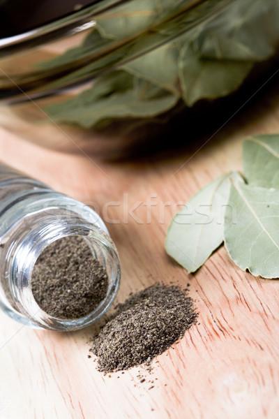 Zwarte peper shaker bladeren houten glas achtergrond Stockfoto © marylooo