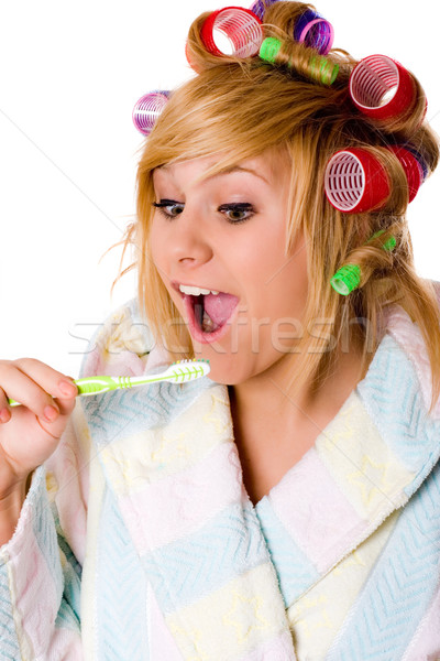 funny housewife with curlers and toothbrush  Stock photo © marylooo