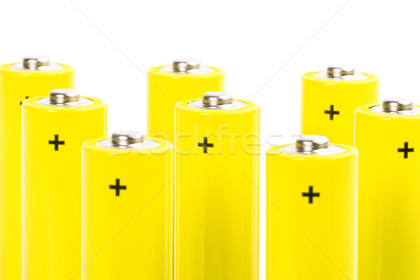 Stock photo: eight yellow alkaline batteries