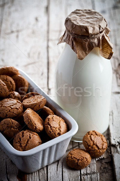 meringue almond cookies in a bowl and bottle of milk  Stock photo © marylooo