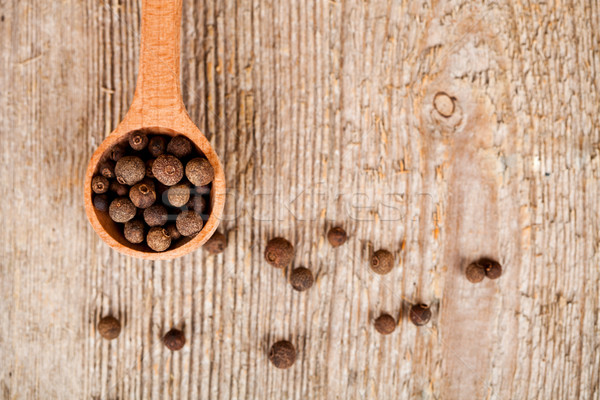 pimento in wooden spoon Stock photo © marylooo