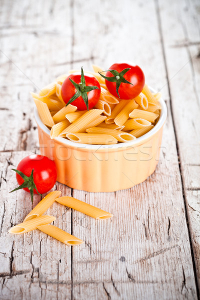 uncooked pasta and cherry tomatoes in a bowl Stock photo © marylooo