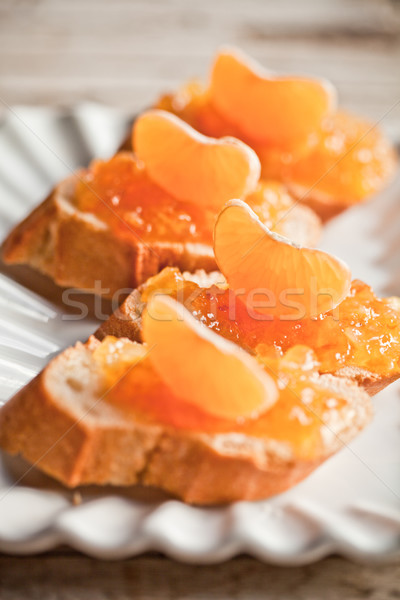 pieces of baguette with orange marmalade Stock photo © marylooo