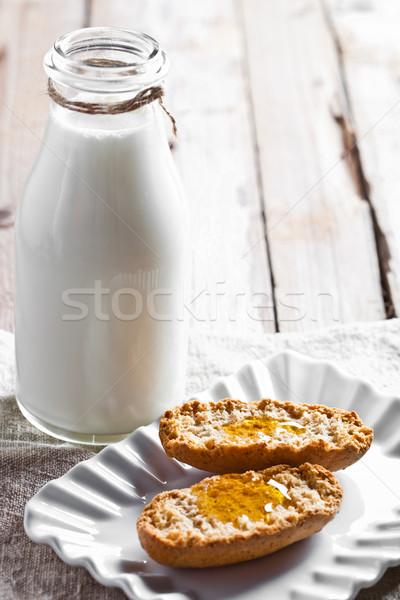 bottle of milk and crackers with honey Stock photo © marylooo