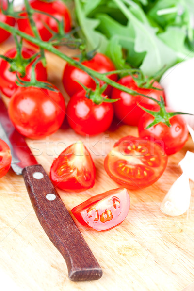 fresh tomatoes, rucola, garlic and old knife  Stock photo © marylooo