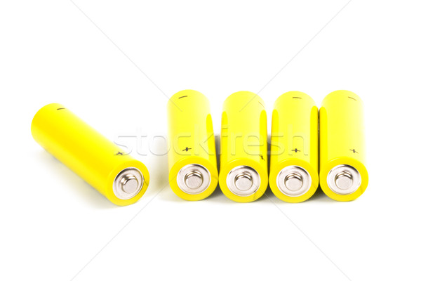 five yellow alkaline batteries Stock photo © marylooo