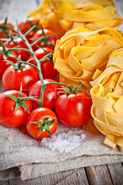 Stock photo: uncooked pasta and fresh tomatoes