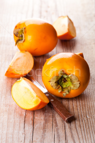 fresh sliced persimmons and knife  Stock photo © marylooo