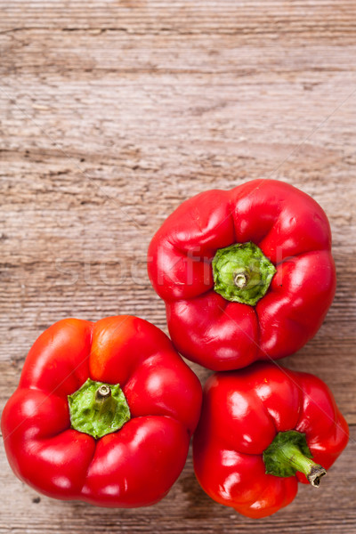 peppers on rustic wooden table Stock photo © marylooo