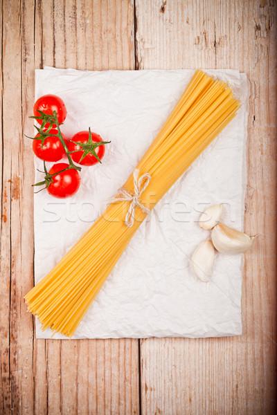 uncooked pasta with tomatoes and garlic Stock photo © marylooo