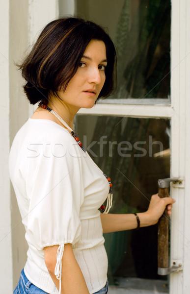 attractive woman opening the door Stock photo © marylooo