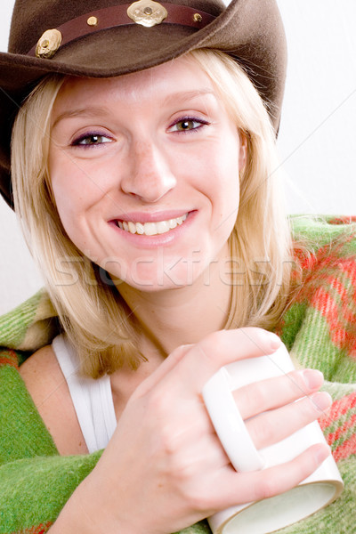 girl in a cowboy hat with cup of tea Stock photo © marylooo