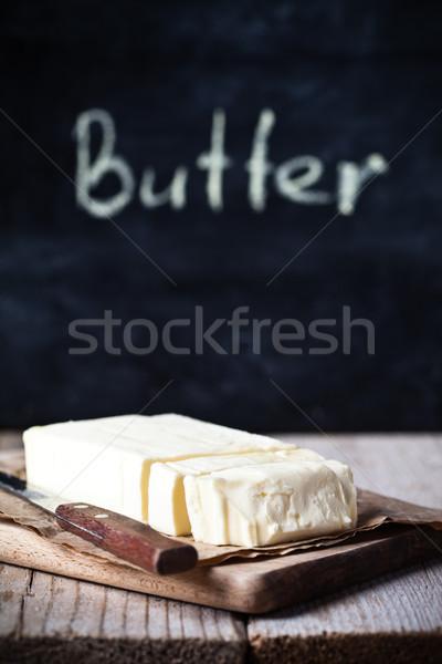 Fraîches beurre tableau noir rustique table en bois alimentaire Photo stock © marylooo
