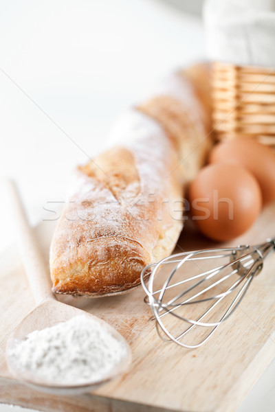 still life of bread, flour, eggs and kitchen utensil Stock photo © marylooo