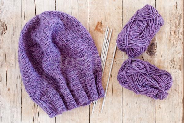 wool purple hat, knitting needles and yarn  Stock photo © marylooo