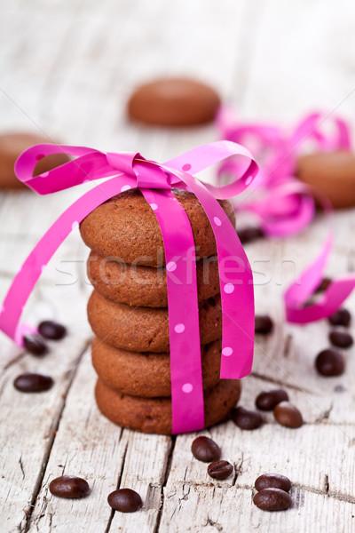 Csokoládé sütik rózsaszín szalag kávé rusztikus fából készült Stock fotó © marylooo