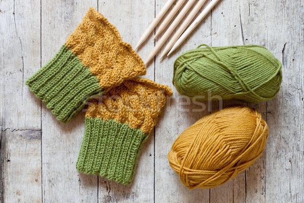wool green and yellow legwarmers, knitting needles and yarn  Stock photo © marylooo