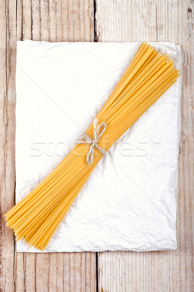 spaghetti on white paper Stock photo © marylooo