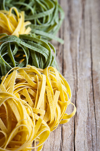 yellow and green uncooked pasta tagliatelle  Stock photo © marylooo