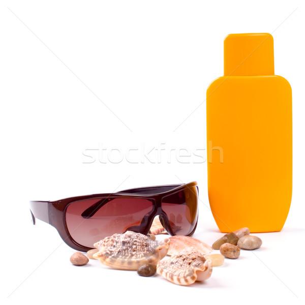 Gafas de sol loción primer plano blanco playa sol Foto stock © marylooo