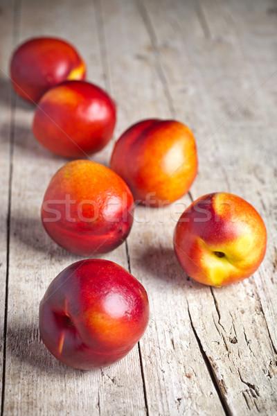 Friss rusztikus fa deszka étel háttér narancs Stock fotó © marylooo