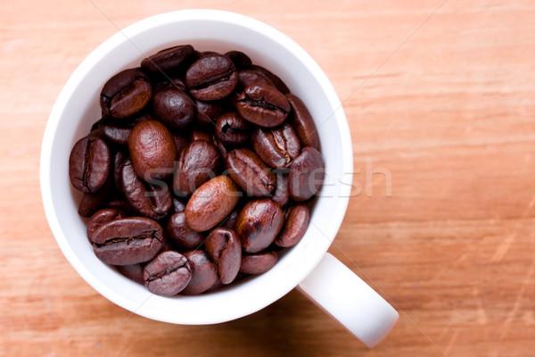Cup completo chicchi di caffè legno legno sfondo Foto d'archivio © marylooo