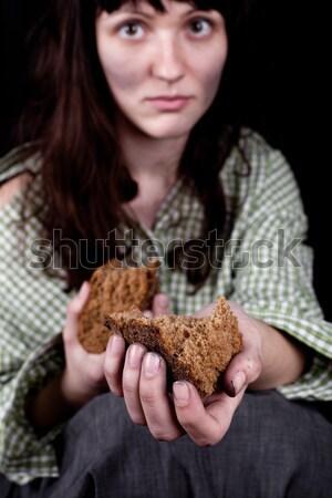 Mendigo mulher alimentação pão retrato pobre Foto stock © marylooo