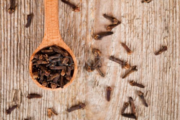 cloves in wooden spoon Stock photo © marylooo
