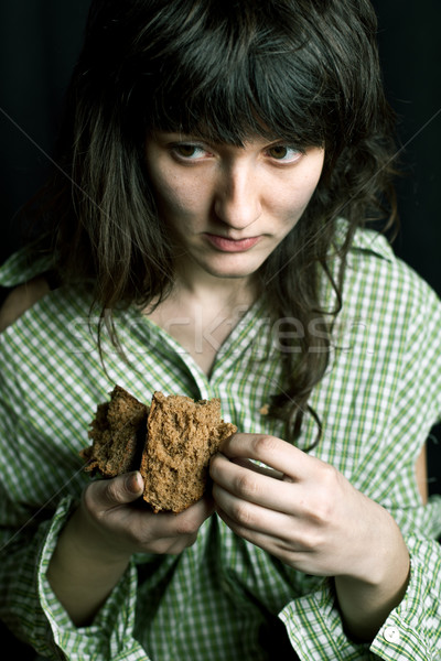 poor beggar woman with a piece of bread Stock photo © marylooo
