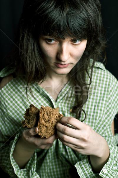 Szegény koldus nő darab kenyér portré Stock fotó © marylooo