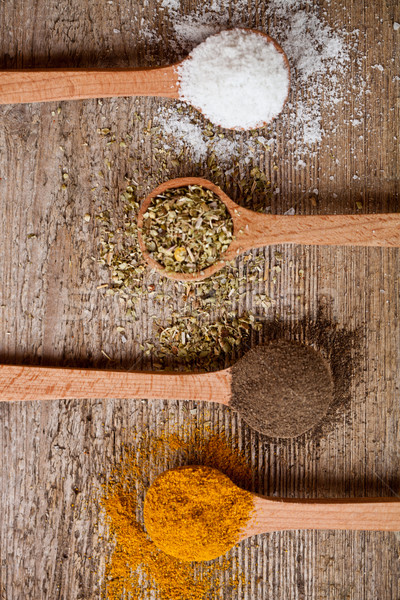 curry, pepper, oregano and cooking salt in wooden spoons Stock fotó © marylooo